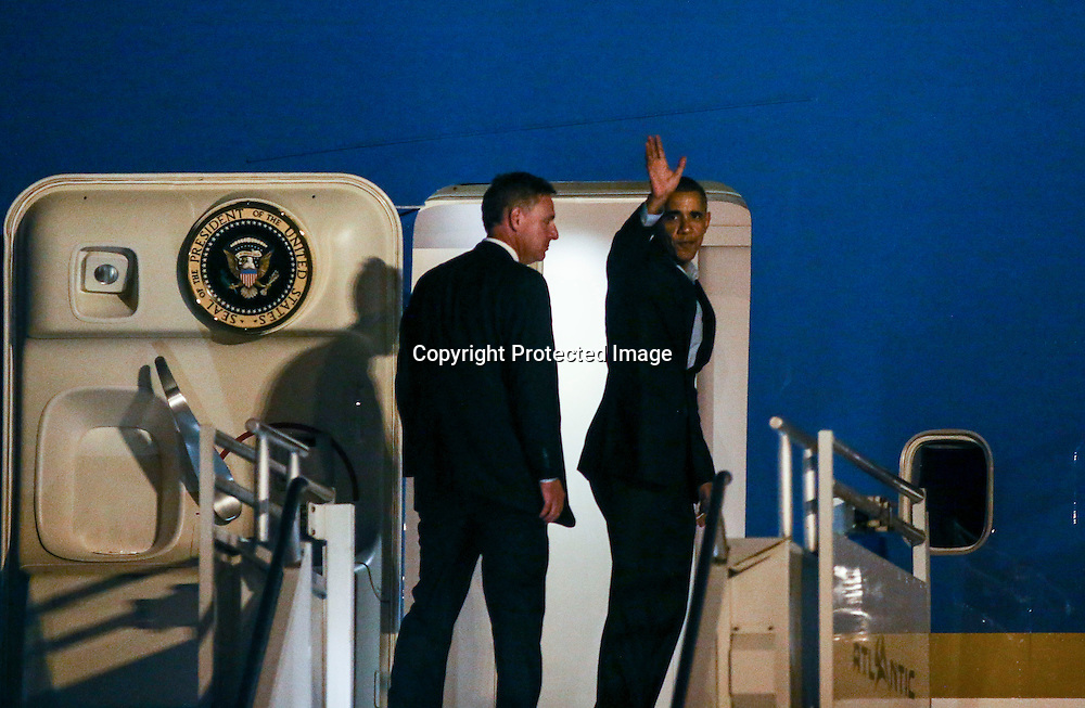 President Barack Obama, right, waves as he boards Air Force One with Rep Scott Peter upon his departure from Los Angeles International Airport in Los Angeles on Saturday, Oct. 10, 2015.  (AP Photo/Ringo H.W. Chiu)