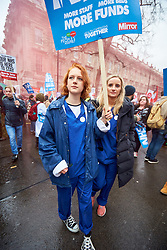 © Licensed to London News Pictures. 03/02/2018. LONDON, UK.  Protesters march through Whitehall calling for increased funding for the NHS.  Photo credit: Cliff Hide/LNP
