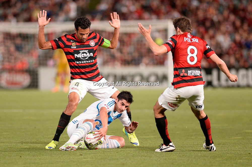 06.01.2015. Sydney, Australia. Hyundai A-League Round 14. Western Sydney Wanderers FC v Melbourne Victory FC. Wanderers defender Nikolai Topor-Stanley and Victory midfielder Gui Finkler.Victory won the game 2-1.