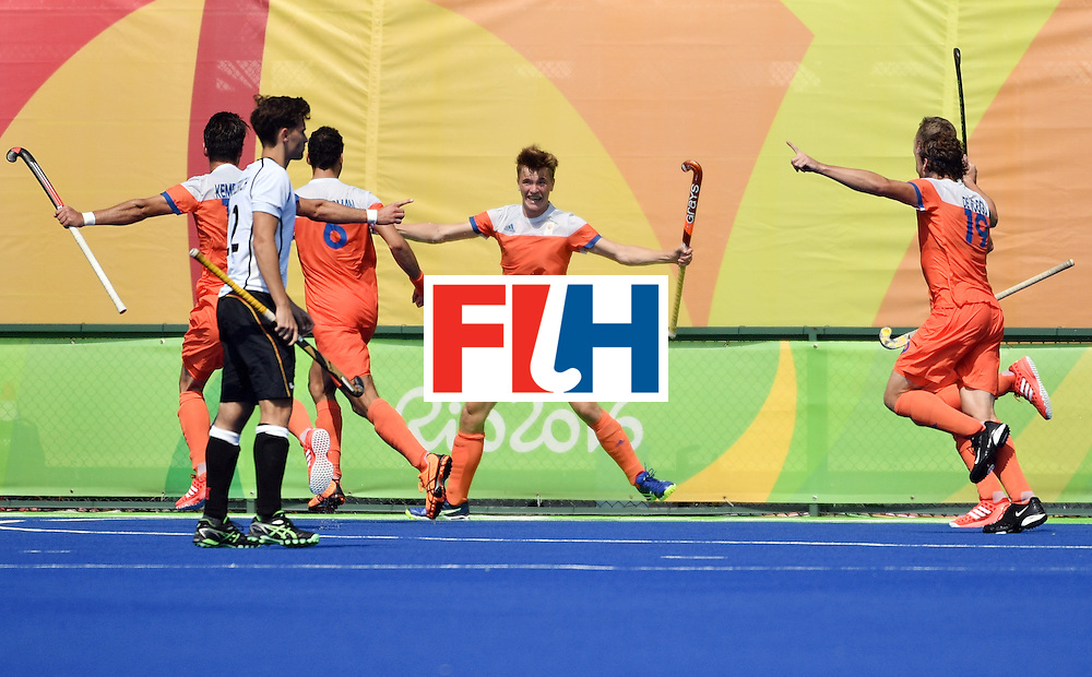 Netherlands' Jorrit Croon (C) celebrates with teammates after scoring a goal during the men's Bronze medal field hockey Netherlands vs Germany match of the Rio 2016 Olympics Games at the Olympic Hockey Centre in Rio de Janeiro on August 18, 2016. / AFP / Pascal GUYOT        (Photo credit should read PASCAL GUYOT/AFP/Getty Images)