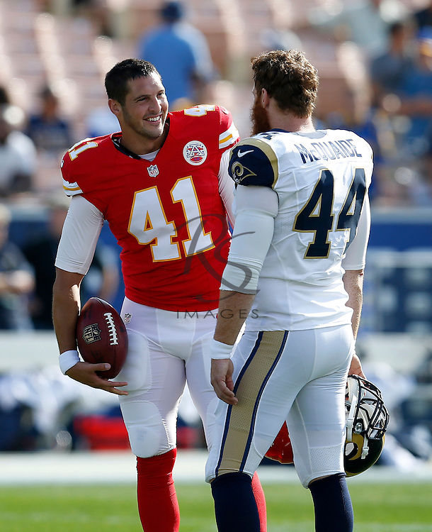 Kansas City Chiefs long snapper James Winchester, left, talks with Los Angeles Rams long snapper Jake McQuaide prior to a preseason NFL football game, Saturday, Aug. 20, 2016, in Los Angeles. (AP Photo/Rick Scuteri)