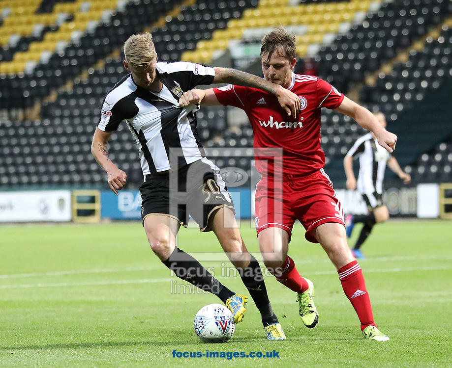 Jon Stead (left) of Notts County is closed down by Mark Hughes of Accrington Stanley during the Sky Bet League 2 match at Meadow Lane, Nottingham<br /> Picture by James Wilson/Focus Images Ltd 07522 978714<br /> 25/08/2017