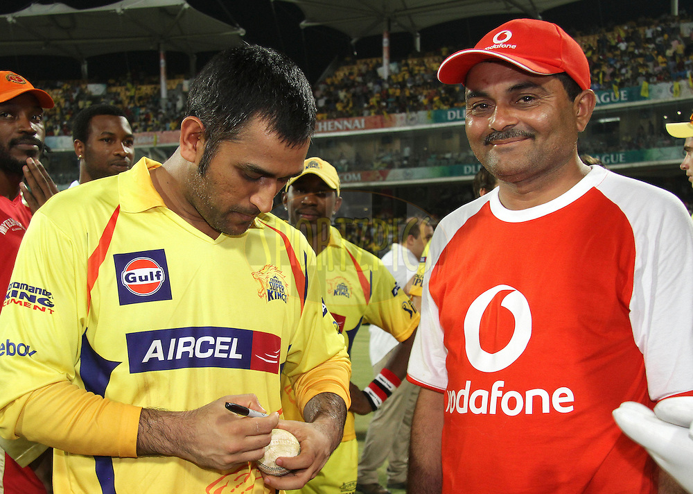Captain MS Dhoni of the Chennai Super Kings signs the ball for the Vodafone Star of the Match during the final of the Indian Premier League ( IPL ) Season 4 between the Chennai Superkings and the Royal Challengers Bangalore held at the MA Chidambaram Stadium in Chennai, Tamil Nadu, India on the 28th April 2011..Photo by Shaun Roy/BCCI/SPORTZPICS