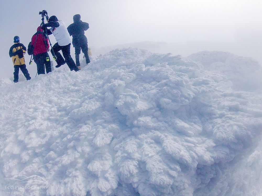 Photographers on ths summit of New Hampshire's Mount Washington in winter.