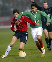 SAN FRANCISCO, CAL   25-01-2006<br /> <br /> Rafael Marquez (#21 Mexico), Moen Petter Vaagan (#9 Noruega) during friendly match between Mexico and Norway at Monster Park stadium in San Francisco, California, on January, 25, 2006<br /> <br /> <br /> <br /> FOTO ©ALEJANDRO MELENDEZ  Clasos/Graffiti