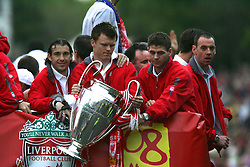 LIVERPOOL, ENGLAND - THURSDAY, MAY 26th, 2005: Liverpool's Josemi, John Arne Riise and Steven Gerrard parade the European Champions Cup on on open-top bus tour of Liverpool in front of 500,000 fans after beating AC Milan in the UEFA Champions League Final at the Ataturk Olympic Stadium, Istanbul. (Pic by David Rawcliffe/Propaganda)
