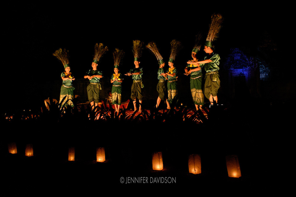 Apsara dancers perform at the Banteay Samre temple at night.
