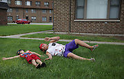 Joshua Foreman, 3, left, and his cousin Xavier Herrera, 7, play at their home at the West Calumet Housing Complex in East Chicago.