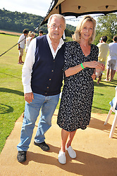 TERRY O'NEILL and LORAINE ASHTON at a cricket match to in aid of CARE - Corfu Animal Rescue Establishment held at Hawkley Cricket Club, Hawkley, Hampshire on 8th September 2012.