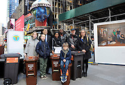 "Award-winning photojournalist Peter Menzel, second right, and writer Faith D'Aluisio, right, join New York families featured in their ground-breaking photo series, ""Waste in Focus,"" sponsored by The Glad Products Company, Thursday, April 10, 2014 in New York. The photo series reveals the amount of trash U.S. families produce in an average week. Visit wasteinfocus.com to learn more about the photo exhibit.  (Photo by Diane Bondareff/Invision for The Glad Products Company/AP Images)"