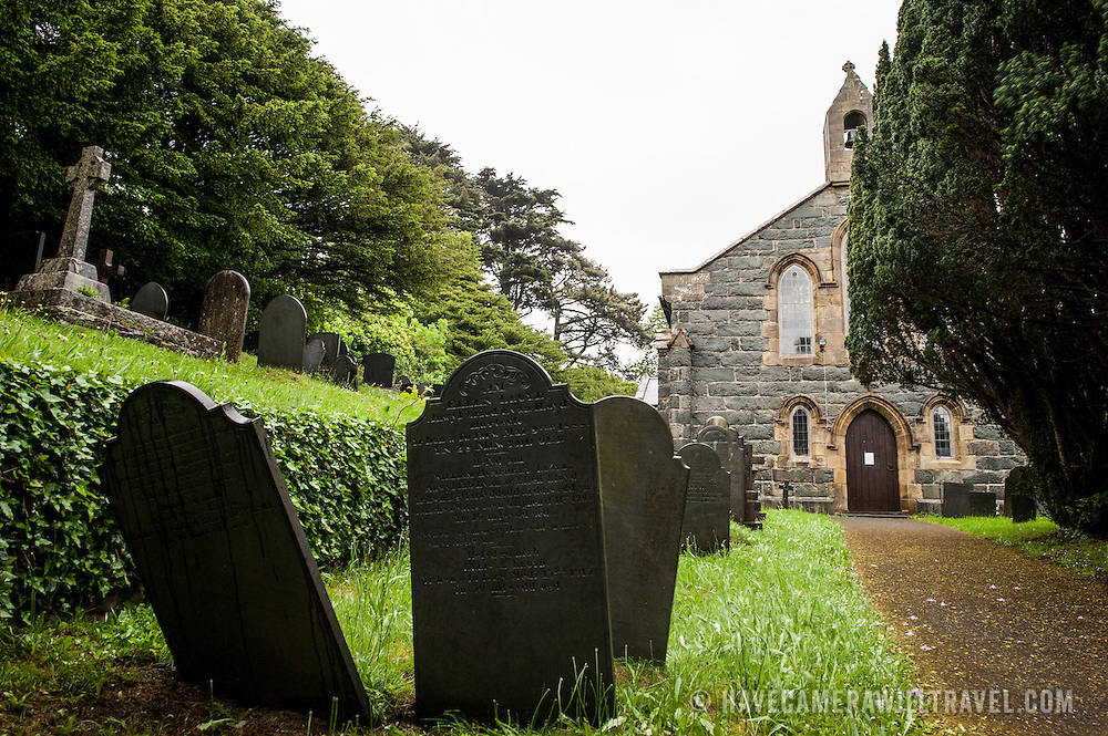 Graveyard headstones and path leading to the front of St. Tanwg's Church in Harlech on Wales's northwestern coast, in Snowdonia.