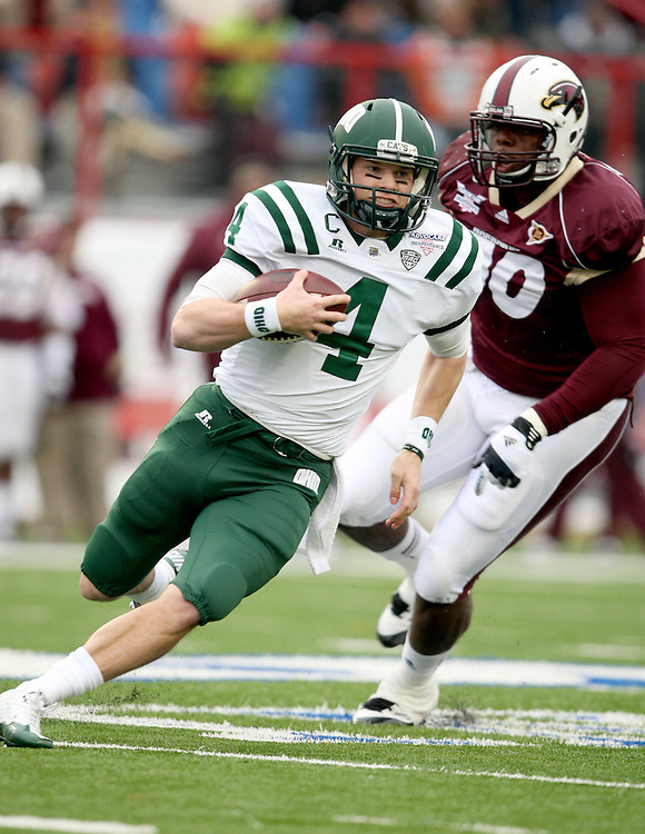 Ohio quarterback Tyler Tettleton evades Louisiana-Monroe defenders as part of a first down run during the first quarter of the Independence Bowl NCAA college football game, Friday, Dec. 28, 2012, in Shreveport, La.