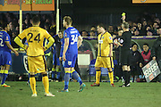 Sutton United defender Jamie Collins (6) yellow card during the The FA Cup third round replay match between AFC Wimbledon and Sutton United at the Cherry Red Records Stadium, Kingston, England on 17 January 2017. Photo by Matthew Redman.