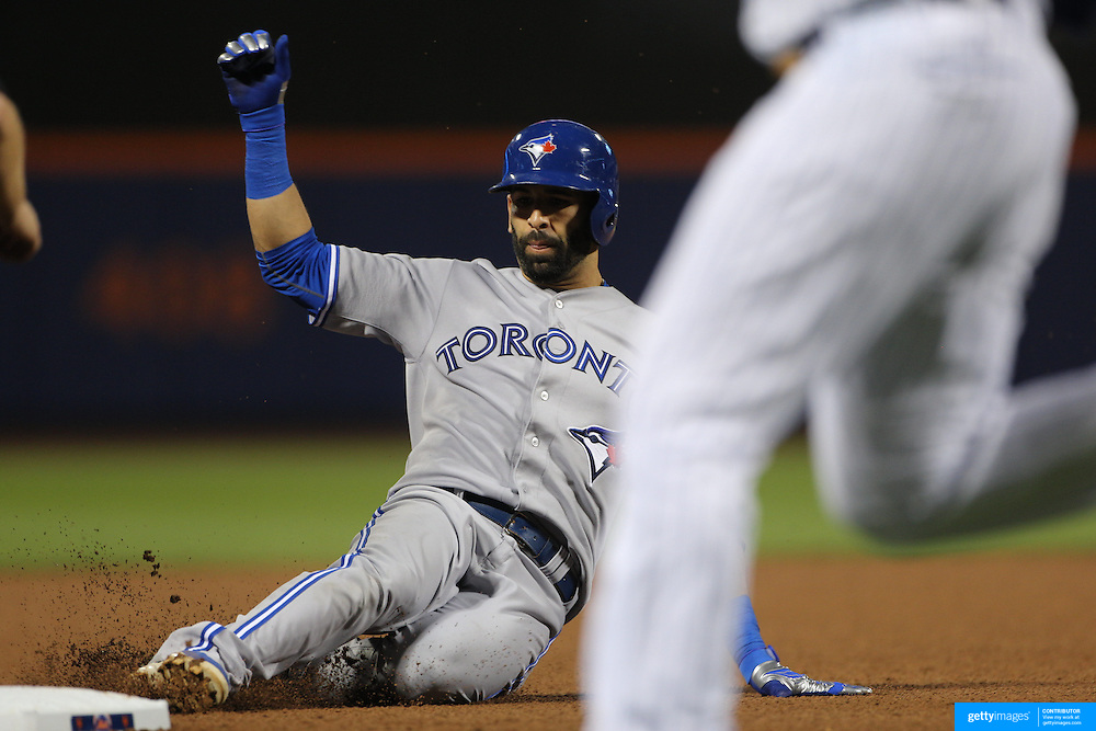 Jose Bautista, Toronto Blue Jays, slides into third base for a triple during the New York Mets Vs Toronto Blue Jays MLB regular season baseball game at Citi Field, Queens, New York. USA. 16th June 2015. Photo Tim Clayton