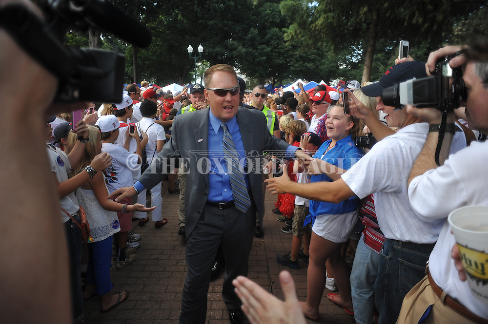 Ole Miss Coach Hugh Freeze coach walks the Grove on his way to Vaught-Hemingway Stadium in Oxford, Miss. on Saturday, September 1, 2012. Mississippi is hosting Central Arkansas to open the season...