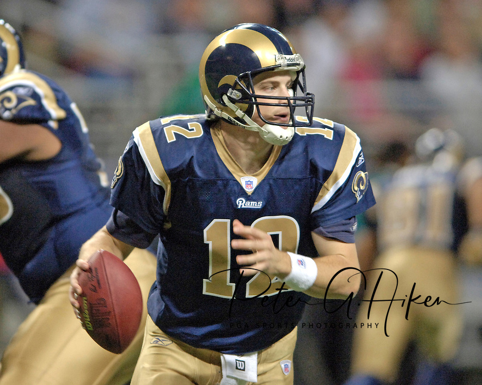 St. Louis Rams quarterback Ryan Fitzpatrick rolls out of the pocket agaisnt Philadelphia, at the Edward Jones Dome in St. Louis, Missouri, December 18, 2005.  The Eagles beat the Rams 17-16.