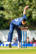 Scotland cricketer Safyaan Sharif bowls during the One Day International match between Scotland and Afghanistan at The Grange Cricket Club, Edinburgh, Scotland on 10 May 2019.
