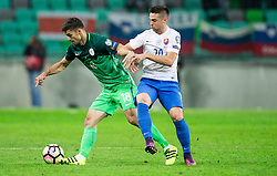 Rok Kronaveter of Slovenia vs Robert Mak of Slovakia during football match between National teams of Slovenia and Slovakia in Round #2 of FIFA World Cup Russia 2018 qualifications in Group F, on October 8, 2016 in SRC Stozice, Ljubljana, Slovenia. Photo by Vid Ponikvar / Sportida
