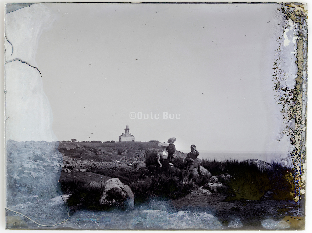 mother with children at a viewing spot by the sea early 1900s