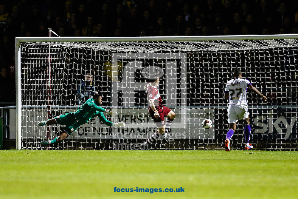 Alfie Potter of Oxford United (not shown) scores their third goal during the Sky Bet League 2 match at Sixfields Stadium, Northampton<br /> Picture by Andy Kearns/Focus Images Ltd 0781 864 4264<br /> 21/10/2014