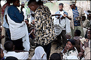 "Guests of two early marriages shall pay money as a sign of respect and gifts for the child brides' families, just after the religious function. North West of Ethiopia, on saturday, Febrary 14 2009.....In a tangled mingling of tradition and culture, in the normal place of living, in a laid-back attitude. The background of Ethiopia's ""child brides"", a country which has the distinction of having highest percentage in the practice of early marriages despite having a law that establishes 18 years as minimum age to get married. Celebrations that last days, their minds clouded by girls cups of tella and the unknown for the future. White bridal veil frame their faces expressive of small defenseless creatures, who at the age ranging from three to twelve years shall be given to young brides men adults already...To protect the identities of the recorded subjects names and specific places are fictional."