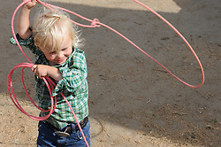 "Young roper Max Cohn, 3, gets some practice before Friday's ""Fight Hunger Night"" at the California Rodeo Salinas."