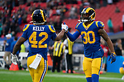 LA Rams Running Back Todd Gurley (30) and LA Rams Running Back John Kelly (42) warm up during the International Series match between Los Angeles Rams and Cincinnati Bengals at Wembley Stadium, London, England on 27 October 2019.