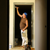 Jerry Wildman Jr., a contracted painter with Southland Construction, puts a coat of paint around door trim Thursday morning as he and his crew make sure the inside of the new Tupelo-Lee Humane Society's building will be ready for occupation. Officials say staff will start moving in July 1, but the organization still needs a final $200,000 to retire its debt from the building. The Tupelo-Lee Humane Society will be hosting a variety of fundraising activities this wummer to work on the debt.