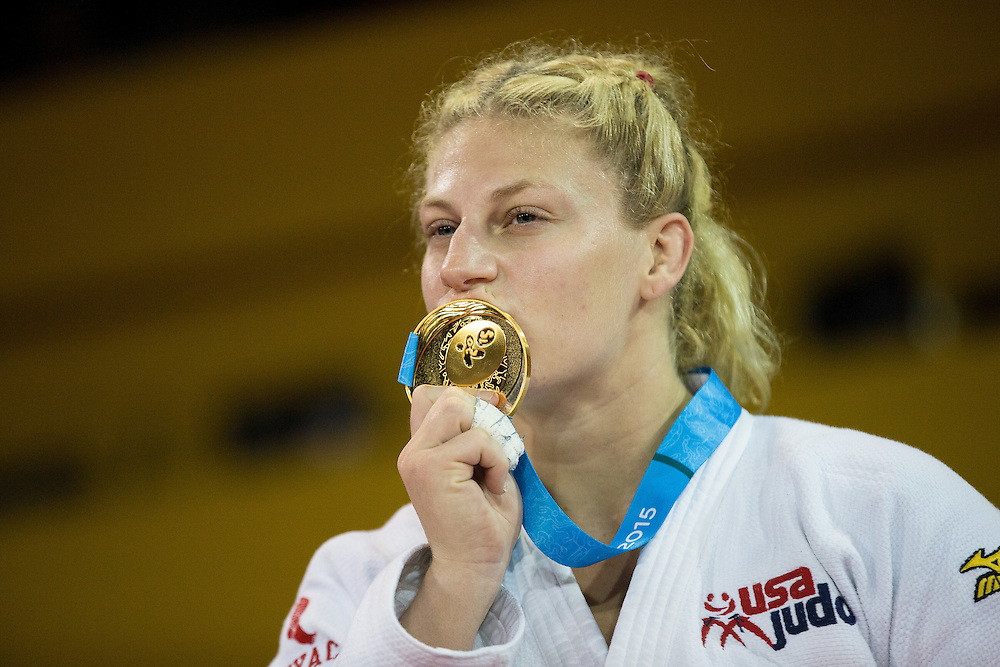 Gold medalist  Kayla Harrison of the United States  kisses her medal following the medal ceremonies for the women's judo -78 kg class at the 2015 Pan American Games in Toronto, Canada, July 14,  2015.  AFP PHOTO/GEOFF ROBINS