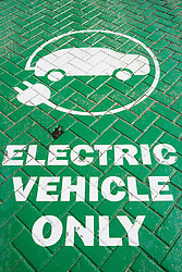Sign on parking bay at electric vehicle charging point