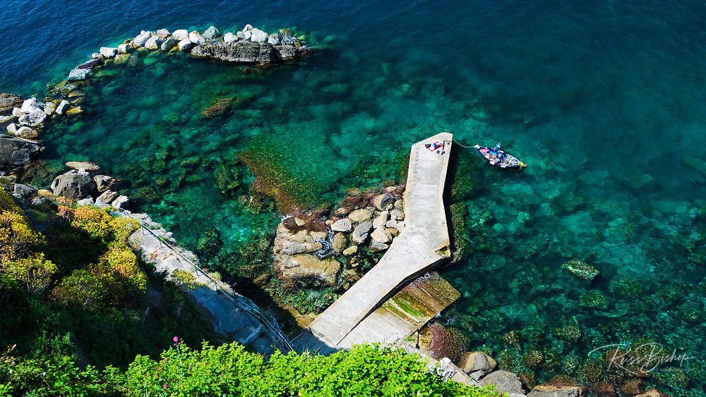 Dock and breakwater at Corniglia, Cinque Terre, Liguria, Italy