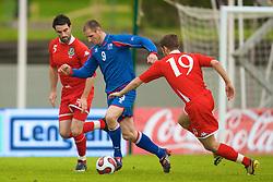 REYKJAVIK, ICELAND - Wednesday, May 28, 2008: Wales' Craig Morgan and Iceland's Stefan Thordarson during the international friendly match at the Laugardalsvollur Stadium. (Photo by David Rawcliffe/Propaganda)