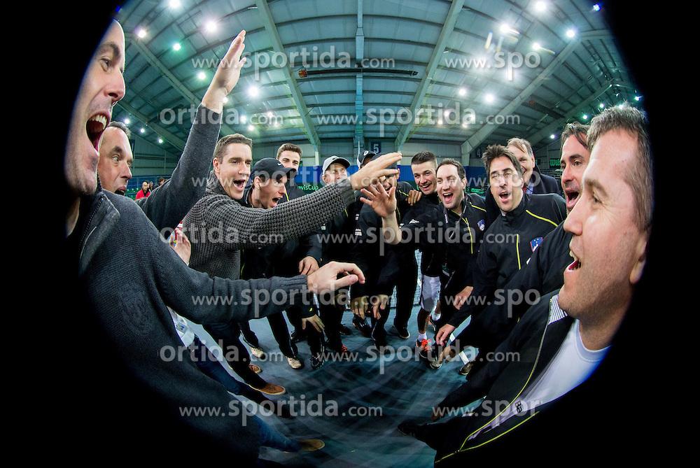 Team Slovenia (L-R): Ziga Ham, Gasper Bolhar, Lea Stumberger, Gregor Krusic, Janez Semrajc, Blaz Bizjak, Tom Kocevar-Desman, Grega Zemlja, Blaz Kavcic, Mike Urbanija, Miha Mihalic, Marko Umberger, Ziga Janskovec, Blaz Trupej and Matej Tusak after the 5th match of Davis cup Slovenia vs. Portugal on February 2, 2014 in Kranj, Slovenia. Photo by Vid Ponikvar / Sportida