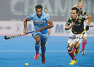 BHUBANESWAR  (INDIA)  - HERO Champions Trophy Hockey men. Day 1. Germany vs India.  Dharamvir Singh of India and Dan Nguyen Luong of Germany. PHOTO  KOEN SUYK
