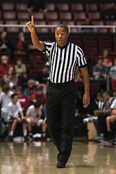 Official Keith Kimble makes a call during the first half of an NCAA college basketball game between Stanford and Colorado in Stanford, Calif., Sunday, Jan. 3, 2016. Colorado won 56-55. (AP Photo/Jason O. Watson)