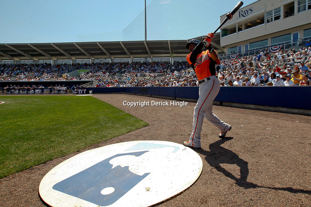 March 20, 2011; Port Charlotte, FL, USA; Baltimore Orioles center fielder Adam Jones (10) prepares to bat during a spring training exhibition game against the Tampa Bay Rays at Charlotte Sports Park.   Mandatory Credit: Derick E. Hingle