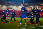 AFC Wimbledon midfielder Mitch Pinnock (11) warming up during the The FA Cup match between Doncaster Rovers and AFC Wimbledon at the Keepmoat Stadium, Doncaster, England on 19 November 2019.