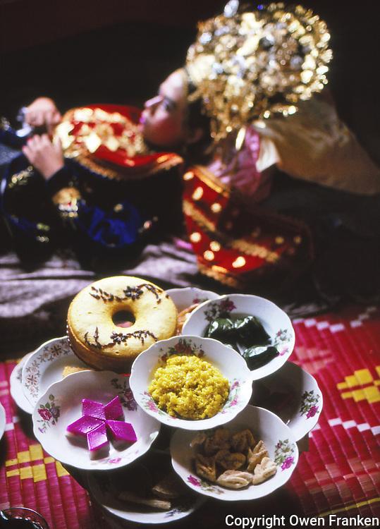wedding meal and sleeping bride, Sumatra, Indonesia