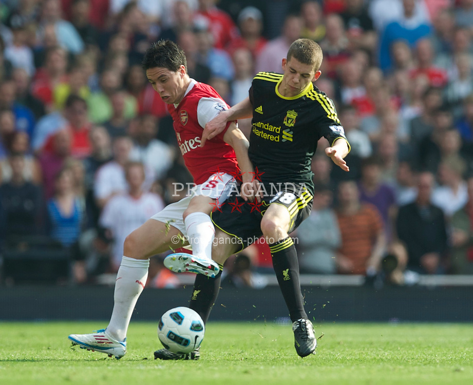 LONDON, ENGLAND - Sunday, April 17, 2011: Liverpool's John Flanagan tackles Arsenal's Samir Nasri, which he received a yellow card for, during the Premiership match at the Emirates Stadium. (Photo by David Rawcliffe/Propaganda)