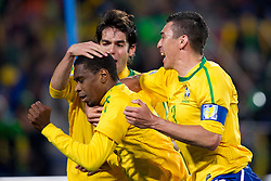 Juan of Brazil, Kaka and Lucio of Brazil celebrate after Juan scored during the 2010 FIFA World Cup South Africa Round of Sixteen match between Brazil and Chile at Ellis Park Stadium on June 28, 2010 in Johannesburg, South Africa.  (Photo by Vid Ponikvar / Sportida)