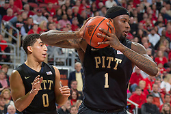 Pittsburgh forward Jamel Artis, right, grabs an offensive rebound in the first half. <br /> <br /> The University of Louisville hosted the University of Pittsburgh, Wednesday, Feb. 11, 2015 at Yum Center in Louisville. <br /> <br /> Photo by Jonathan Palmer