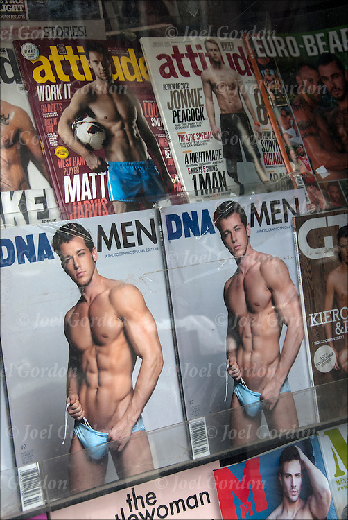 Sex is everywhere in the American Culture today. semi nude males on covers in newsstand window used to sell Gay Magazines in Newsstand in West Village, New York City