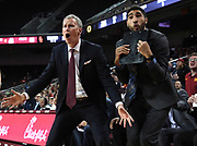 Feb 21, 2019; Los Angeles, CA, USA; Southern California Trojans head coach Andy Enfield (left) and graduate assistant Nick Hamilton react in the second half against the Oregon Ducks at Galen Center. USC defeated Oregon 66-49.