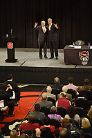 Chancellor Randy Woodson (left) and new athletics director Boo Corrigan pose for a photo during a press conference.