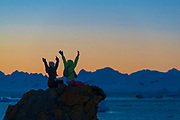 Visitors to the Antarctica at Georges Point, Ronge Island, during sunset