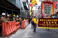 Construction workers take a break to observe members of the Dragon and Lion Dance Team in Chinatown.