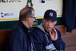 OAKLAND, CA - JUNE 14:  Joe Girardi #28 of the New York Yankees talks to Major League Baseball executive and former manager Joe Torre in the dugout before the game against the Oakland Athletics at O.co Coliseum on June 14, 2014 in Oakland, California. The Oakland Athletics defeated the New York Yankees 5-1.  (Photo by Jason O. Watson/Getty Images) *** Local Caption *** Joe Girardi; Joe Torre