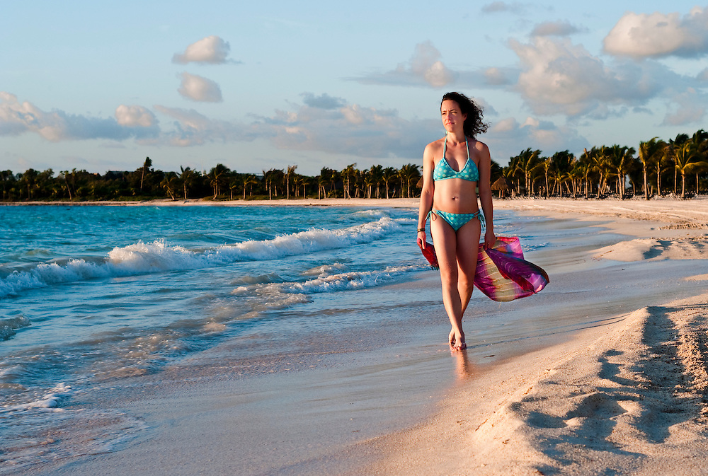 Young healthy woman walking on a mexican beach.