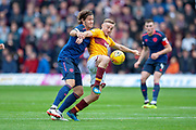 Allan Campbell (#8) of Motherwell FC holds off Peter Haring (#5) of Heart of Midlothian during the Ladbrokes Scottish Premiership match between Motherwell and Heart of Midlothian at Fir Park, Motherwell, Scotland on 15 September 2018.