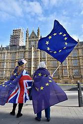 "© Licensed to London News Pictures. 30/01/2018. LONDON, UK.  Campaigners gather outside the Houses of Parliament to protest against Brexit waving European Union flags.  It has been reported that a leaked document entitled ""EU Exit Analysis - Cross Whitehall Briefing"", drawn up by the Department for Exiting the EU, concludes that Britain will be worse off under any Brexit scenario.   Photo credit: Stephen Chung/LNP"